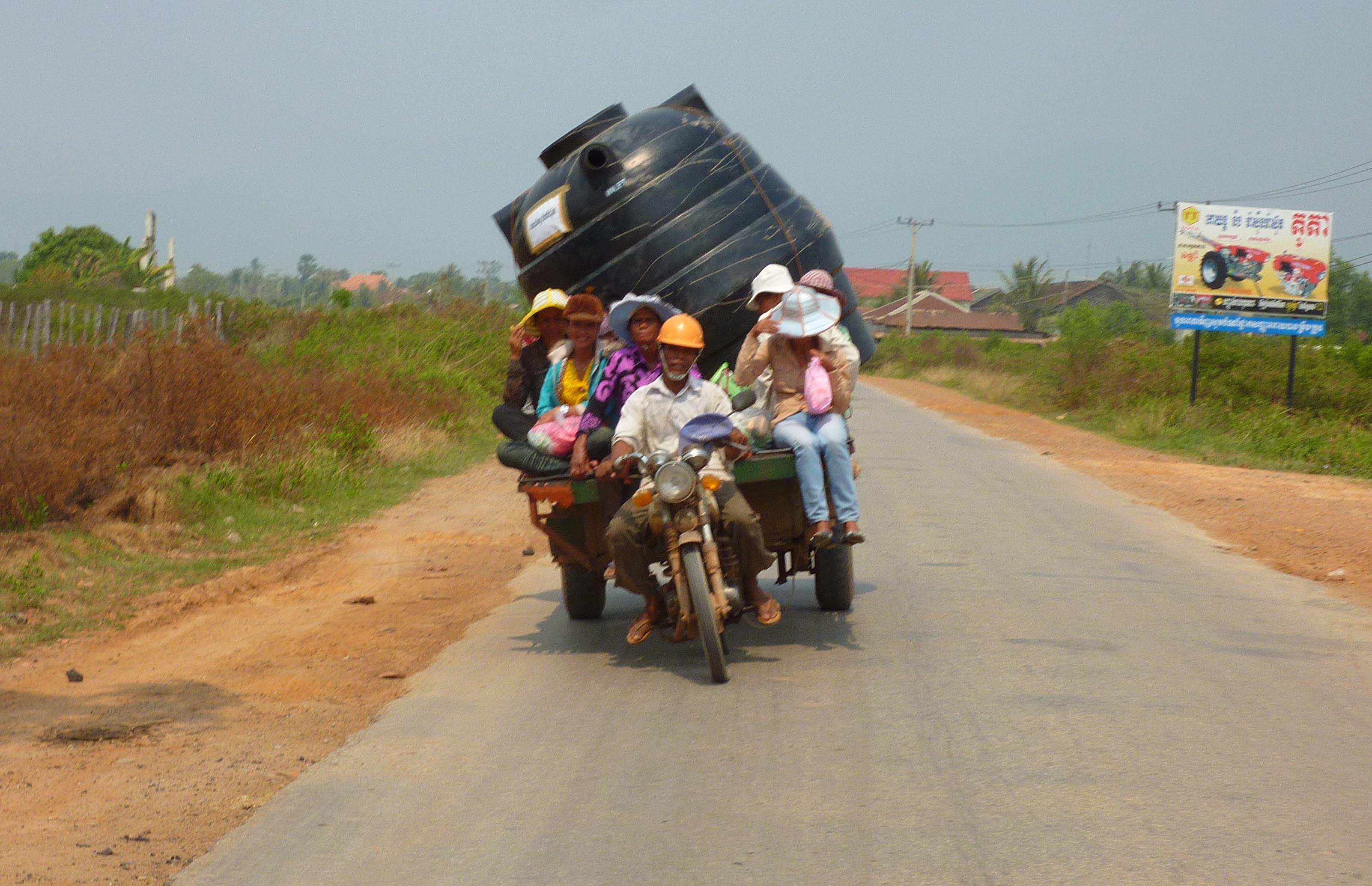 people in tuktuk